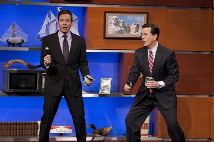 "In this publicity image released by Comedy Central, TV personalities, Jimmy Fallon, left, of ""Late Night with Jimmy Fallon,"" and Stephen Colbert of ""The Colbert Report,"" are shown during the taping of Colbert's show, Thursday, March 3, 2011, in New York.  Both men have been the inspiration for Ben & Jerry's  ice cream flavors, ""Americone Dream"" for Colbert and ""Late Night Snack"" for Fallon. (AP Photo/Comedy Central)"