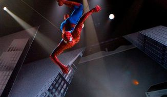 """In this theater publicity image released by The O and M Co., the Spider-Man character is suspended in the air in a scene from the musical """"Spider-Man: Turn Off the Dark,"""" in New York. (AP Photo/The O and M Co., Jacob Cohl)"""