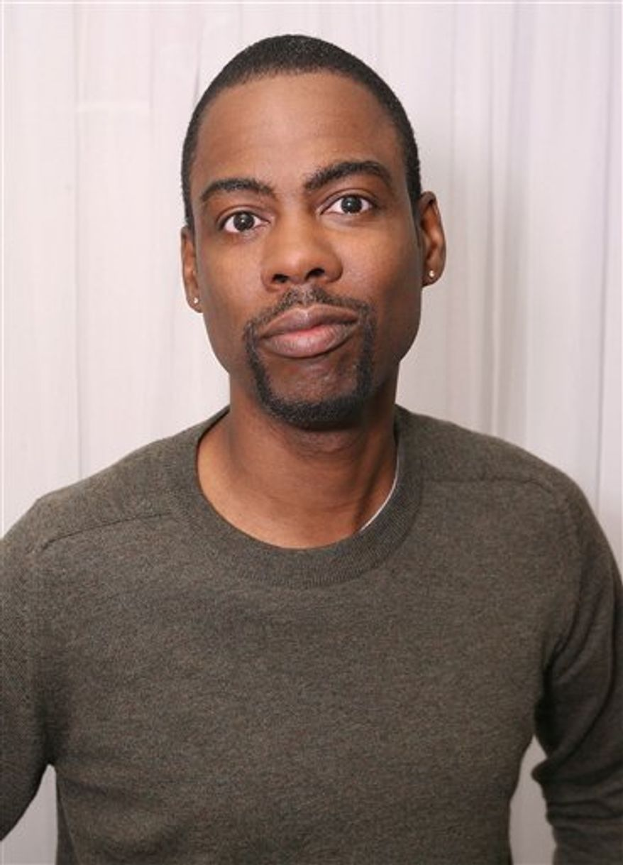 ** FILE ** In this Sept. 14, 2009, file photo originally released by InStyle, Chris Rock is seen at the InStyle Lounge at the Toronto International Film Festival in Toronto. (AP Photo/Casey Rodgers, InStyle)