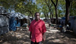 Serge Michel Dorval, a Haitian citizen deported from the U.S., now lives at a refugee camp in Port-au-Prince. (Associated Press)