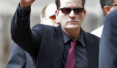 FILE - In this June 7, 2010 file photo, Charlie Sheen leaves the Pitkin County Courthouse with his attorney Richard Cummins in Aspen, Colo. (AP Photo/Ed Andrieski, file)