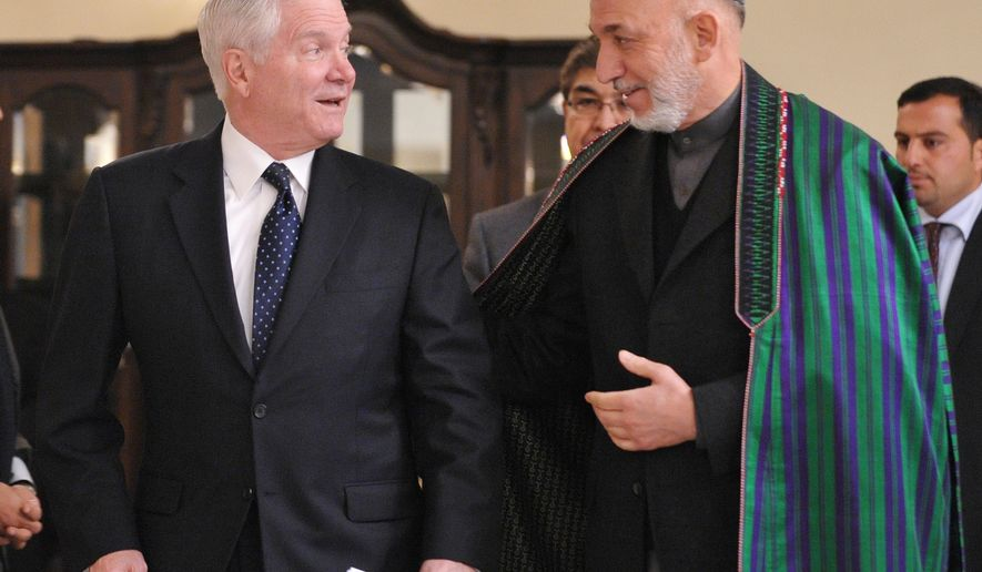 U.S. Defense Secretary Robert M. Gates (left) and Afghan President Hamid Karzai arrive for a joint press conference at the Presidential Palace in Kabul, Afghanistan, on Monday, March 7, 2011. Mr. Gates visited Afghanistan to meet with U.S. troops, allied commanders and Afghan leaders to gauge war progress as the Obama administration moves toward crucial decisions on reducing troop levels. (AP Photo/Mandel Ngan, Pool)