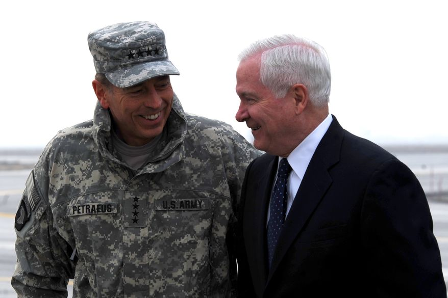 Defense Secretary Robert M. Gates (right) talks with U.S. Army Gen. David H. Petraeus upon the Pentagon chief's arrival in Kabul, Afghanistan, on Monday, March 7, 2011. (AP Photo/Defense Department/Cherie Cullen)
