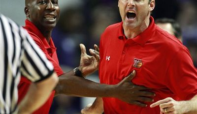 FILE - In a Jan. 15, 2011 file photo, Texas Tech coach Pat Knight, right, is held by assistant coach Stew Robinson after being called for a technical foul during the first half of an NCAA college basketball game against Kansas State, in Manhattan, Kan. Texas Tech has fired coach Pat Knight.  School spokesman Blayne Beal said Monday, March 7, 2011 that Knight will coach the Red Raiders at this week's Big 12 tournament and then will step down.  Knight is in his third year as head coach. He took over the program from his famous father, Bob Knight, midseason in February 2008.  (AP Photo/Orlin Wagner, File)