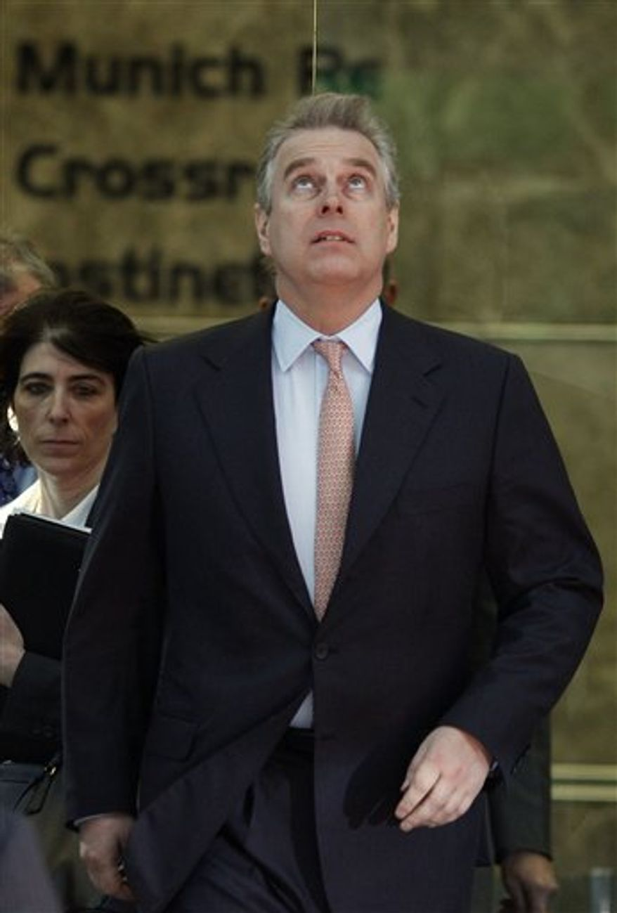 Britain's Prince Andrew looks up as he leaves Canary Wharf, following a visit to the headquarters of the London CrossRail project in London, Monday, March, 7, 2011. Prince Andrew will have to decide whether he can continue his role as a trade envoy amid a controversy about his links to a convicted pedophile, a British Cabinet minister said Monday. (AP Photo/Alastair Grant)