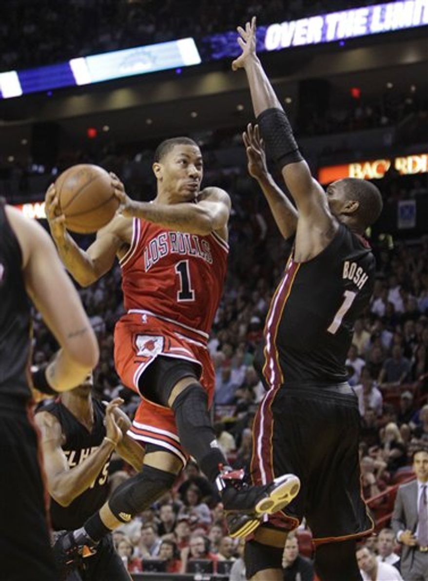 Chicago Bulls' Carlos Boozer, center, yells after the Bulls took a one-point lead in the closing seconds of the fourth quarter during an NBA basketball game against the Miami Heat in Miami, Sunday, March 6, 2011. The Bulls defeated the Heat 87-86. (AP Photo/Lynne Sladky)