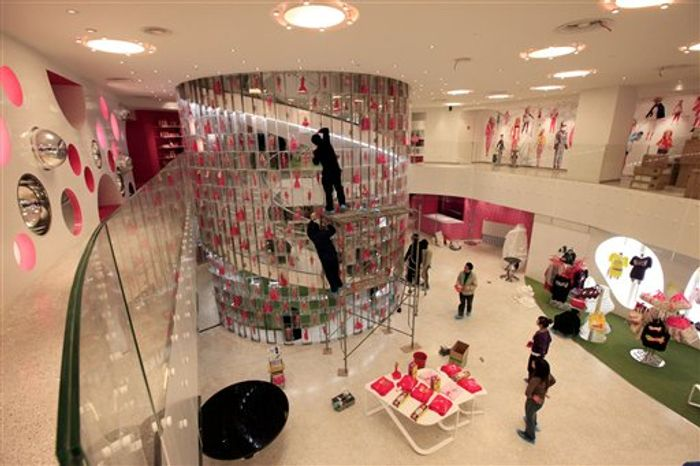 FILE - In this March 5, 2009 file photo, a partial view of the third floor of Barbie's Shanghai flagship store in Shanghai, China, is shown. Barbie is hitting the road as Mattel Inc. closes down its Shanghai flagship store dedicated to the iconic brand after just two years.(AP Photo/Eugene Hoshiko, file)