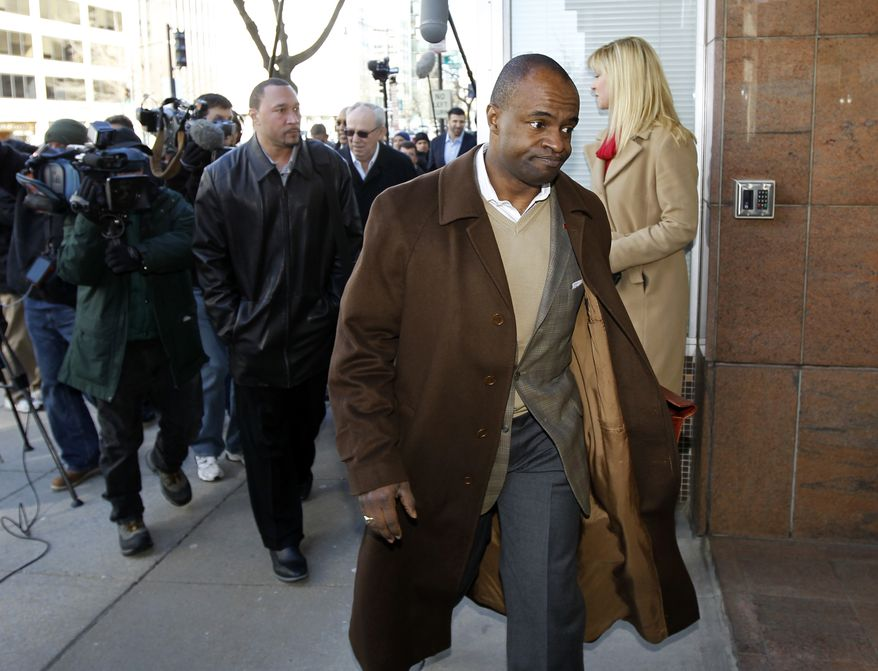 DeMaurice Smith, executive director of the NFL Players Association, walks to negotiations with the NFL involving a federal mediator in Washington, Monday, March 7, 2011 (AP Photo/Alex Brandon)