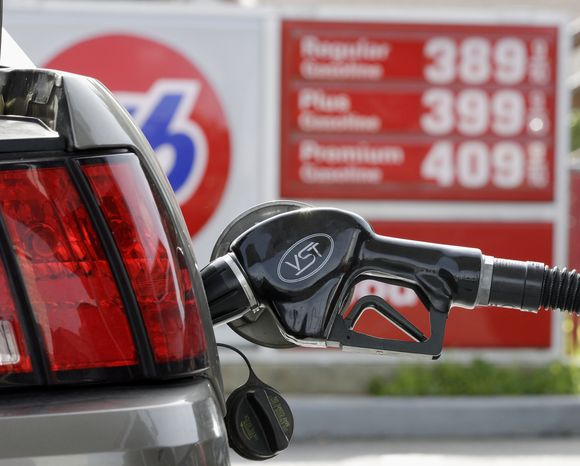 Gas prices are posted Monday in Santa Cruz, Calif. Pump prices have jumped an average of 39 cents per gallon since the Libyan uprising began in mid-February, forcing motorists to pay an additional $146 million per day for the same amount of fuel. (Associated Press)