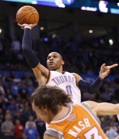 Oklahoma City Thunder guard Russell Westbrook shoots in front of Phoenix Suns guard Steve Nash in the fourth quarter of an NBA basketball game in Oklahoma City, Sunday, March 6, 2011. Oklahoma City won 122-118. (AP Photo/Sue Ogrocki)