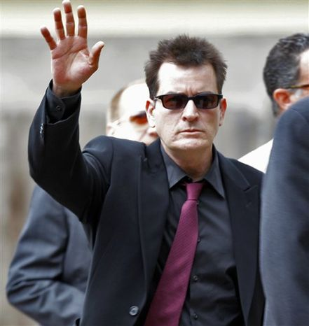 """FILE-  In this file photo provided by ABC News, Andrea Canning interviews actor Charlie Sheen Saturday, Feb. 26, 2011, in Los Angeles for a Special Edition of 20/20 which aired Tuesday, March 1, 2011. Sheen told Canning he is 100 percent clean and plans to show up for work despite CBS's pulling the plug on this season's production of """"Two and a Half Men."""" (AP Photo/ABC News, FILE)"""