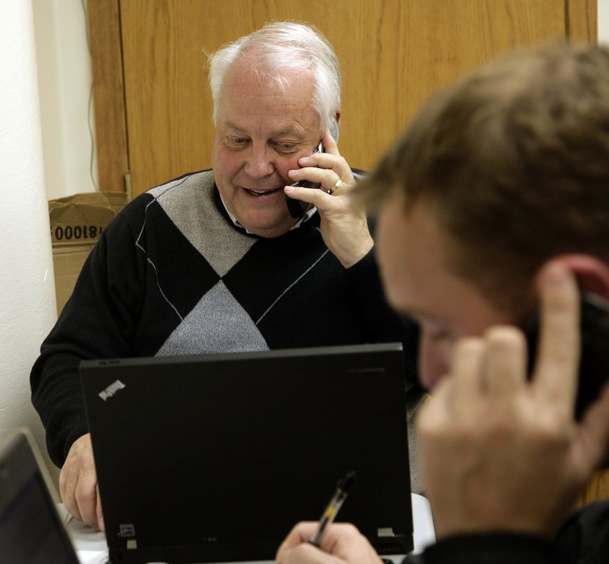 Wisconsin Sen. Robert Jauch, a Democrat,, on the phone at the democratic headquarters in Superior, Wisc, on Nov. 2, 2010. Mr. Jauch is one of the 14 Wisconsin state senators who went to Illinois to avoid voting on Gov. Scott Walker's budget bill. (AP Photo/Leader-Telegram, Paul M. Walsh)