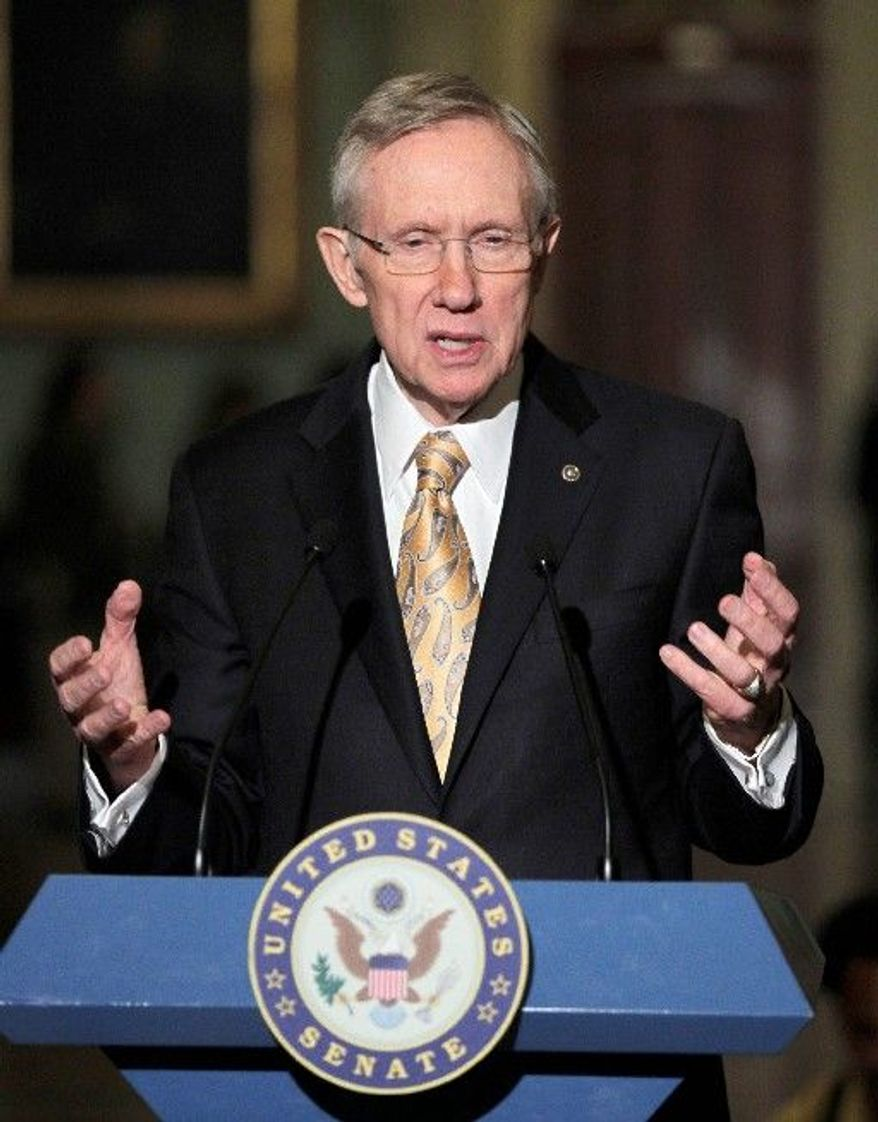 Senate Majority Leader Harry Reid, Nevada Democrat, speaks to reporters after his party's weekly policy luncheon on Capitol Hill on Tuesday. (Associated Press)
