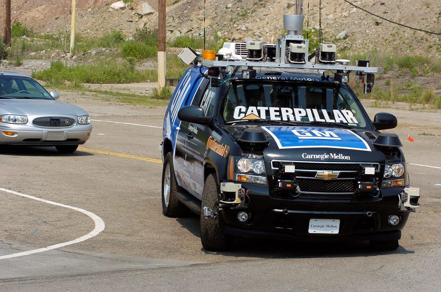 The GM-Carnegie Mellon Collaborative Research Labs' self-driving sport utility vehicle called Boss, a robotized Chevrolet Tahoe, goes through its paces loaded with equipment that allows it to operate without a driver. (Carnegie Mellon University)
