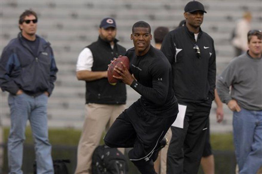 Former Auburn quarterback Cam Newton throws for NFL football scouts during Auburn Pro Day, Tuesday, March 8, 2011, in Auburn, Ala.(AP Photo/Todd J. Van Emst)