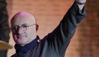 "FILE - In this Sunday, Oct. 17, 2010 file photo British singer Phil Collins waves at the end of his performance at the Italian State RAI TV program ""Che Tempo che Fa"", in Milan, Italy. Phil Collins has taken to his personal website, Tuedsay March 8, 2011 to announce his retirement so he can be a full time father to his two young sons ""on a daily basis"", not because of bad reviews, bad press or because he doesn't ""feel loved"". (AP Photo/Luca Bruno, File)"