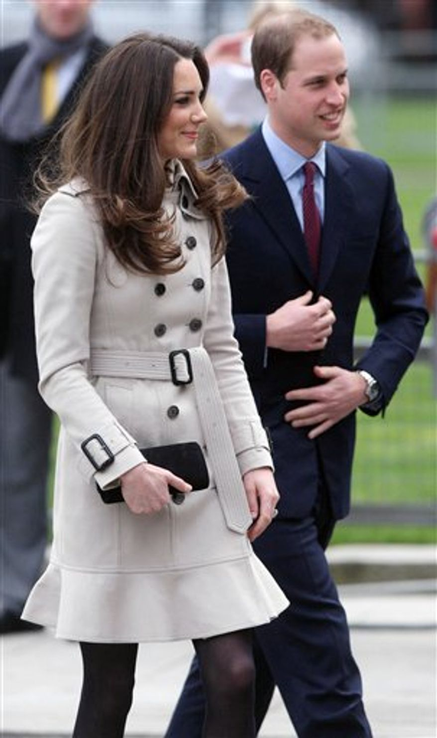 Britain's Prince William, center, and his bride-to-be Kate Middleton, second right, react outside Belfast City Hall, Belfast during their visit to Northern Ireland Tuesday March 8, 2011. Prince William and Kate Middleton traveled to Belfast for their first official visit to Northern Ireland before their April wedding. Police kept watch from the rooftops for a visit that brought the center of Belfast to a standstill.   (AP Photo/Niall Carson, pool)