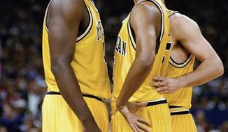 FILE - In this file photo taken November 1991, Michigan's Fab Five from left, Jimmy King, Juwan Howard, Chris Webber, Jalen Rose and Ray Jackson pose in Ann Arbor, Mich. Former college basketball star and ex-NBA player Jalen Rose said an upcoming ESPN film will be an in-depth look at the University of Michigan's Fab 5. (AP Photo/file)