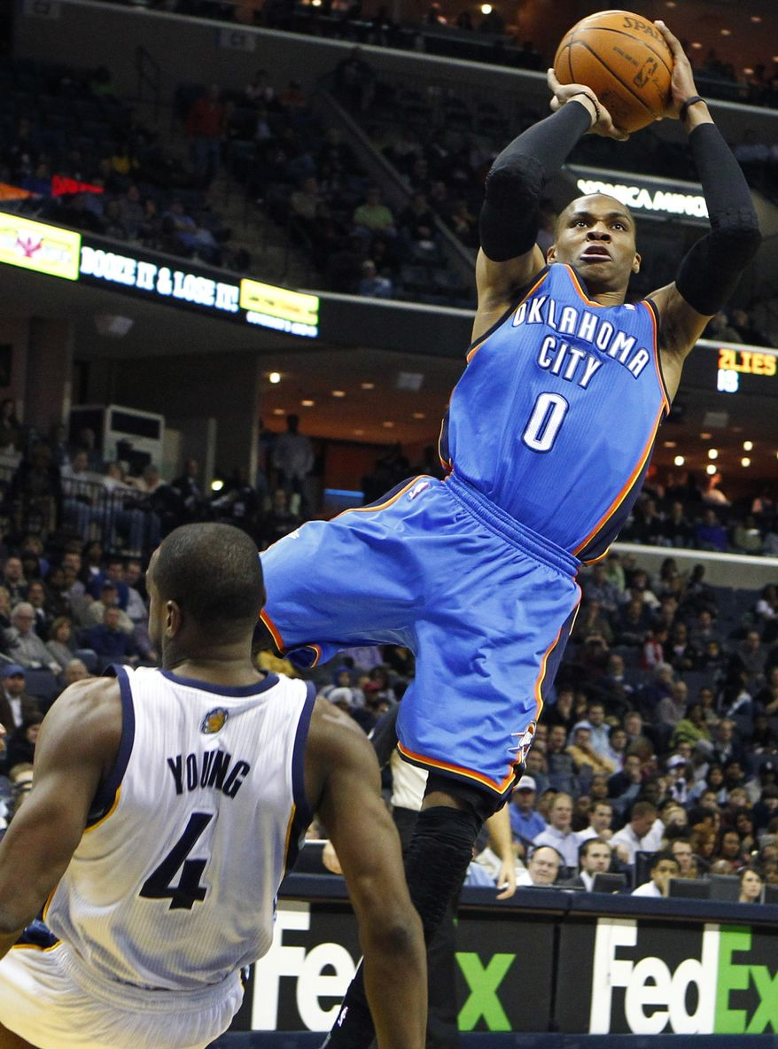 Oklahoma City Thunder's Russell Westbrook (0) drives to the basket while being fouled by Memphis Grizzlies' Sam Young (4) during the first half of an NBA basketball game in Memphis, Tenn., Monday, March 7, 2011. (AP Photo/ Mark Weber)