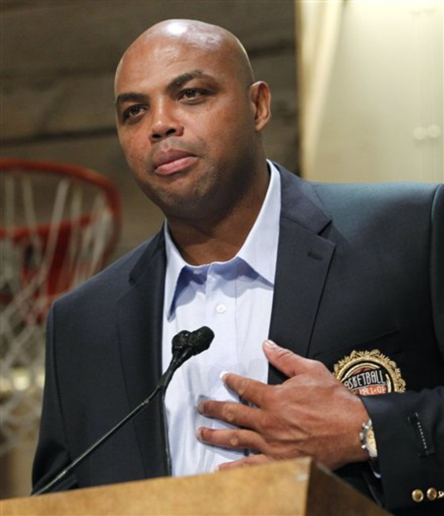 """Basketball Hall of Fame inductee Charles Barkley, representing the 1992 USA Olympic """"Dream"""" Team, pats his heart as he speaks during the enshrinement news conference at the Hall of Fame Museum in Springfield, Mass., on Aug. 13, 2010. (Associated Press) **FILE**"""