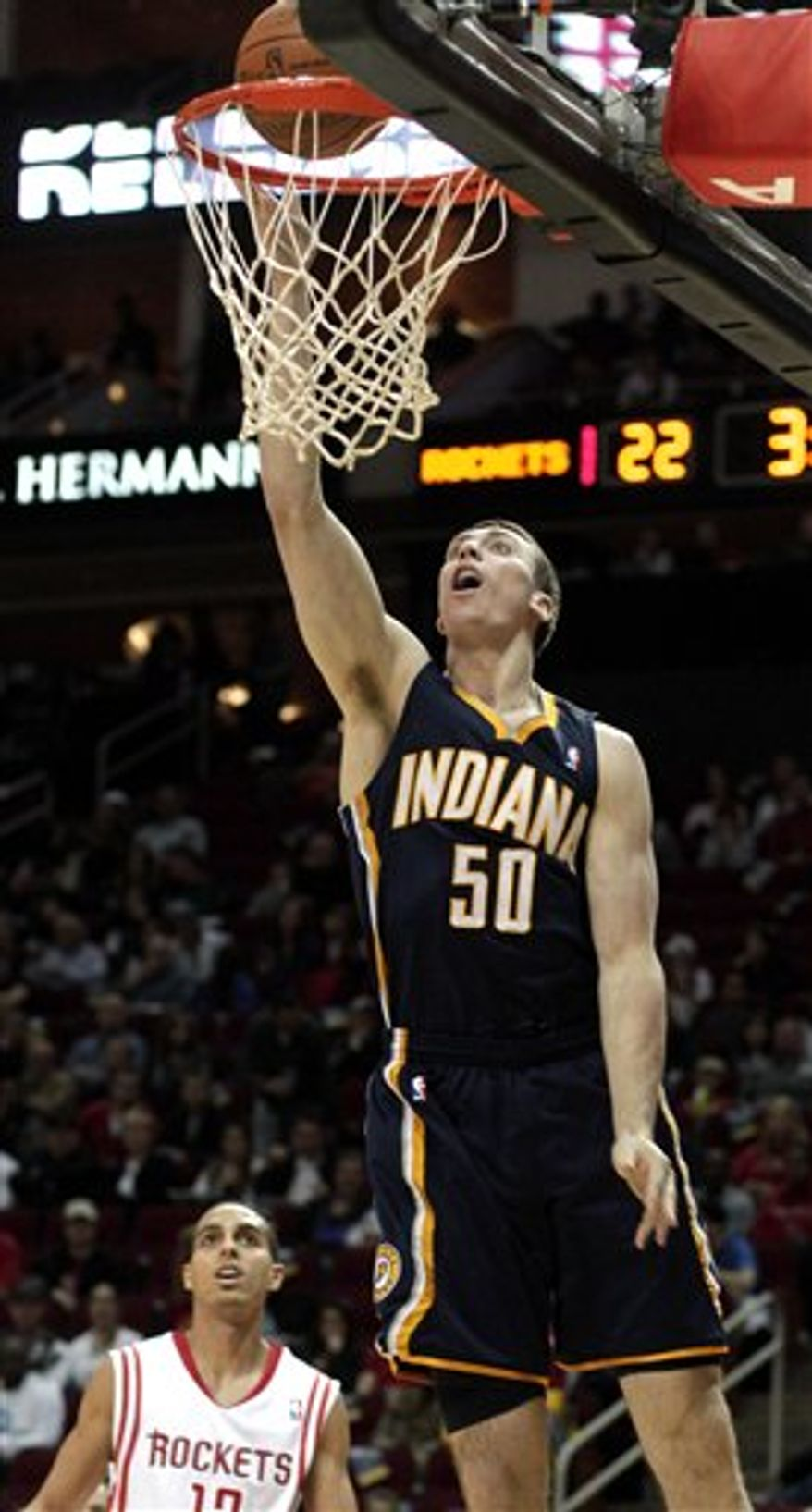 Indiana Pacers' Tyler Hansbrough (50) scores two points in front of Houston Rockets' Kevin Martin (12) during the first half of an NBA basketball game Saturday, March 5, 2011, in Houston. (AP Photo/Pat Sullivan)
