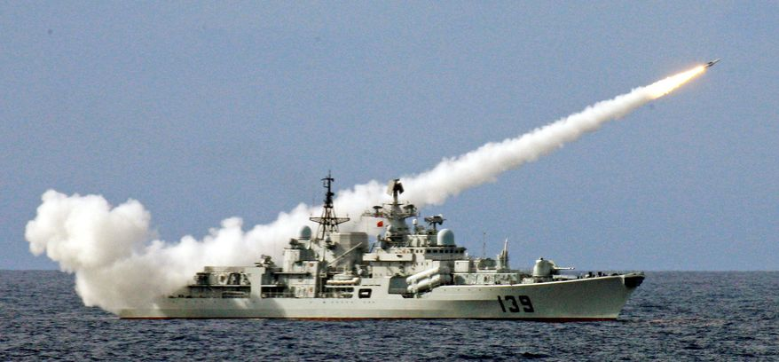 **FILE** A warship launches a missile during a military drill in July 2010 of the South China Sea Fleet of the People's Liberation Army's navy in the South China Sea. (Xinhua News Agency via Associated Press)