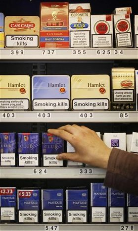 """FILE -- In this June 29, 2010 file photo, tobacco products are displayed in a shop in Glasgow, Scotland. Tobacco will no longer be displayed in shops under new legislation being implemented by Britain's Government in was announced in London, Wednesday May 9, 2011. Only temporary displays in """"certain limited circumstances"""" will be allowed, with the rules phased in to minimise the impact on businesses, according to a statement from the Department of Health.(AP Photo/Danny Lawson, pa, file) UNITED KINGDOM OUT: NO SALES: NO ARCHIVE:"""