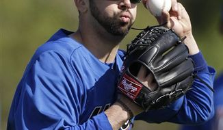 FILE - This Feb. 18, 2011, file photo shows New York Mets starting pitcher Oliver Perez throwing during spring training, in Port St. Lucie, Fla.  Perez appears headed to the bullpen, perhaps his last chance to stick with the team.  The left-hander allowed his first four batters to reach Tuesday, March 8, 2011 against Houston, his final chance to show he deserves a spot in the starting rotation. (AP Photo/Jeff Roberson, File)