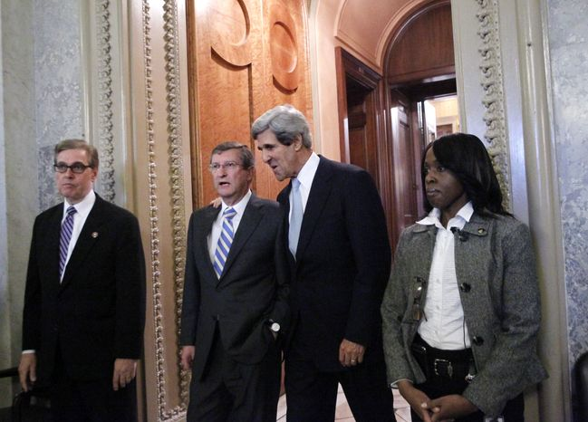 Senate Budget Committee Chairman Kent Conrad (second from left), North Dakota Republican, and Senate Foreign Relations Committee Chairman John Kerry (second from right), Massachusetts Democrat, leave the Senate chamber at the Capitol Wednesday after voting on the spending bill. Late Wednesday, the Senate rejected competing Republican and Democratic spending bills. (Associated Press)
