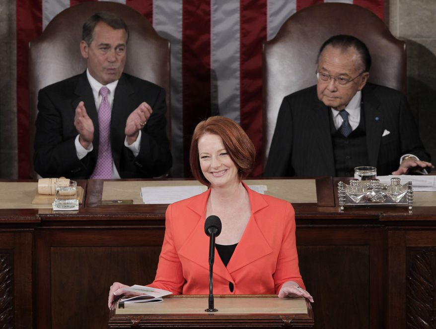 Australian Prime Minister Julia Gillard is flanked by Speaker of the House John A. Boehner, Ohio Republican (left) and Senate President Pro Tempore Daniel K. Inouye, Hawaii Democrat, during her address to a joint session of Congress on Wednesday. She is slated to visit the United Nations in New York on Thursday. (Associated Press)