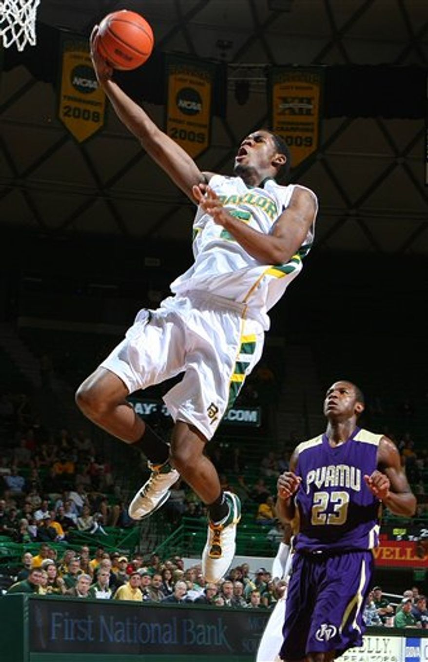 FILE-This Nov. 29, 2011 file photo shows Baylor forward Perry Jones III scoring in front of Prairie View A & M forward Cortney Bell in first half of an NCAA college basketball game  in Waco, Texas. Jones has been declared ineligible by the NCAA and will not play in the Bears' Big 12 Conference tournament opener. Baylor was informed Wednesday March 9, 2011, only hours before the Bears were set to play Oklahoma, that Jones is ineligible. (AP Photo/Waco Tribune-Herald, Jerry Larson,File)