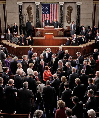 Australian Prime Minister Julia Gillard, at center in red, is surrounded after she addressed a joint meeting of the U.S. Congress in the House of Representatives at the Capitol in Washington, Wednesday, March 9, 2011.  (AP Photo/J. Scott Applewhite)