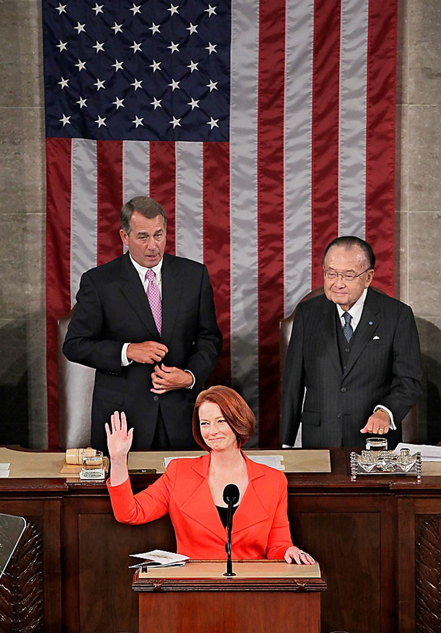 Australian Prime Minister Julia Gillard addresses a joint meeting of the U.S. Congress in the House of Representatives at the Capitol in Washington, Wednesday, March 9, 2011. She is joined by Speaker of the House John Boehner, left, and Sen. Daniel Inouye, president pro tempore of the Senate. (AP Photo/J. Scott Applewhite)