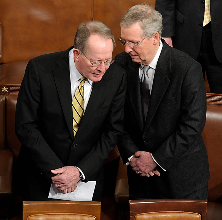 Sen. Lamar Alexander, Tennessee Republican, left, talks with Senate Minority Leader Mitch McConnell, Kentucky Republican, right, before Australian Prime Minister Julia Gillard addresses a joint meeting of Congress on Capitol Hill in Washington, Wednesday, March 9, 2011. (AP Photo/Susan Walsh)