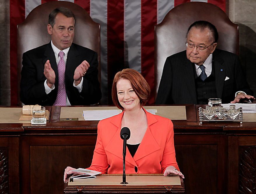 Australian Prime Minister Julia Gillard, center, is flanked by Speaker of the House John Boehner, left, and Senate President Pro Tempore Daniel Inouye, right, as she prepares to address a joint meeting of Congress on Capitol Hill in Washington, Wednesday, March 9, 2011. (AP Photo/J. Scott Applewhite)