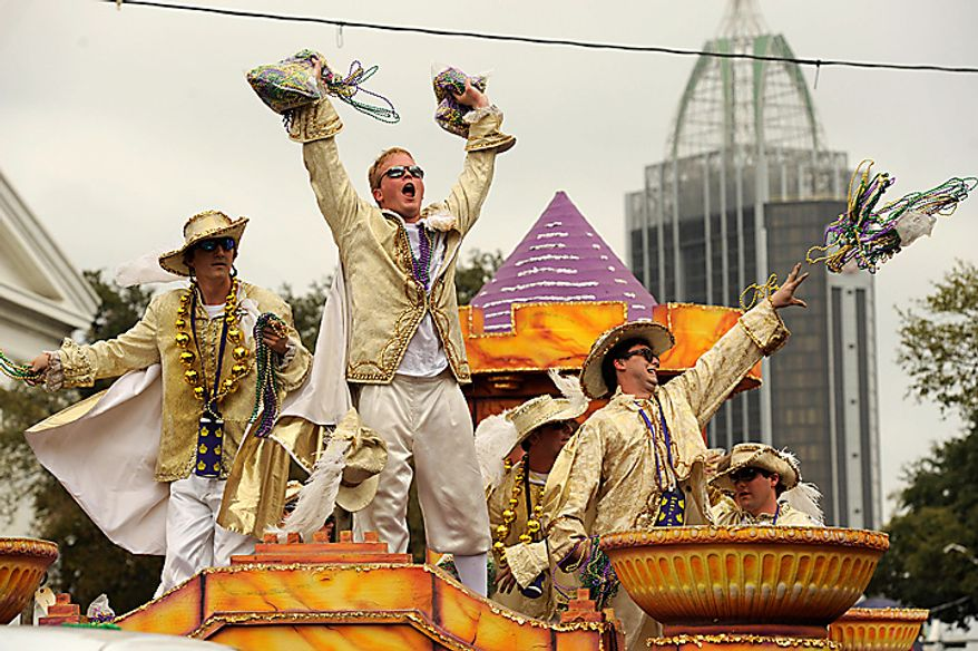 Knights of King Felix III court toss beads to the crowds  gathered on Government Street in Mobile, Ala., Tuesday, March 8, 2011, for the pre-Lenten blowout along the Gulf Coast called Fat Tuesday. (AP Photo/Press-Register, John David Mercer)