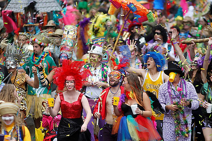 A marching group arrives at Canal Street as it marches ahead of the Krewe of Zulu on Mardi Gras Day in New Orleans, Tuesday, March 8, 2011. (AP Photo/Gerald Herbert)