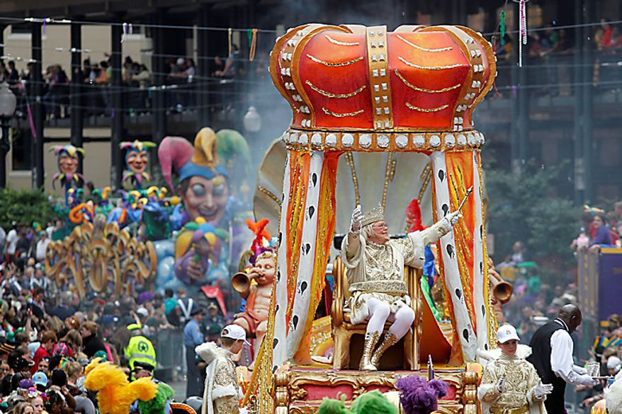 Rex, the King of Carnival rides in the Krewe of Rex as he arrives at Canal St. along St. Charles Avenue on Mardi Gras day in New Orleans, Tuesday, March 8, 2011. (AP Photo/Gerald Herbert)