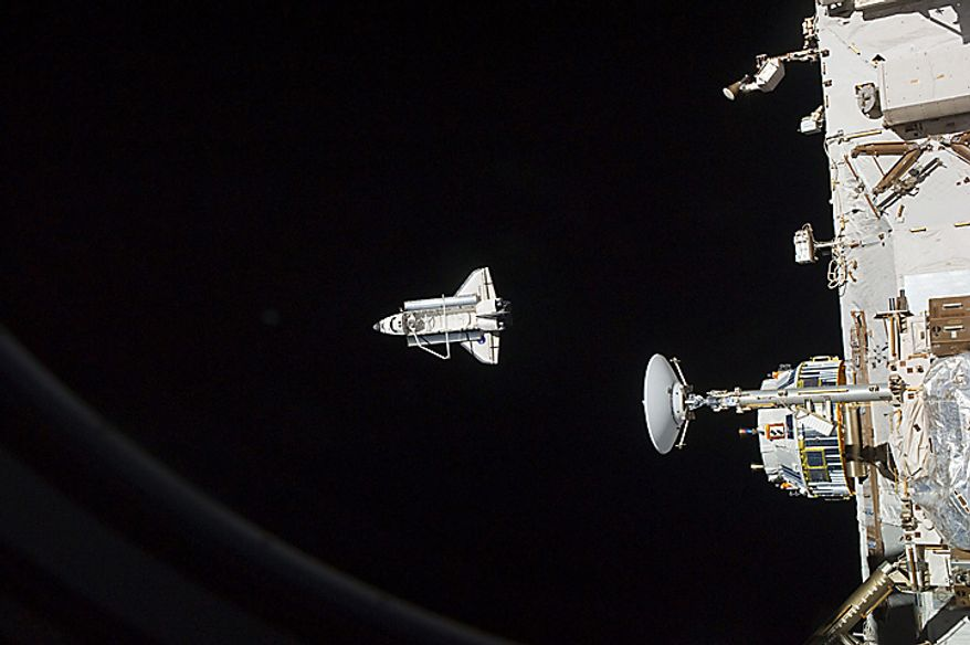 In this image provided by NASA the space shuttle Discovery is seen from the International Space Station as the two orbital spacecraft accomplish their relative separation on March 7, 2011, after an aggregate of 12 astronauts and cosmonauts worked together for over a week. During a post undocking fly-around, the crew members aboard the two spacecraft collected a series of photos of each other's vehicle. Discovery ended its nearly 27-year flying career when it landed Wednesday.  (AP Photo/NASA)