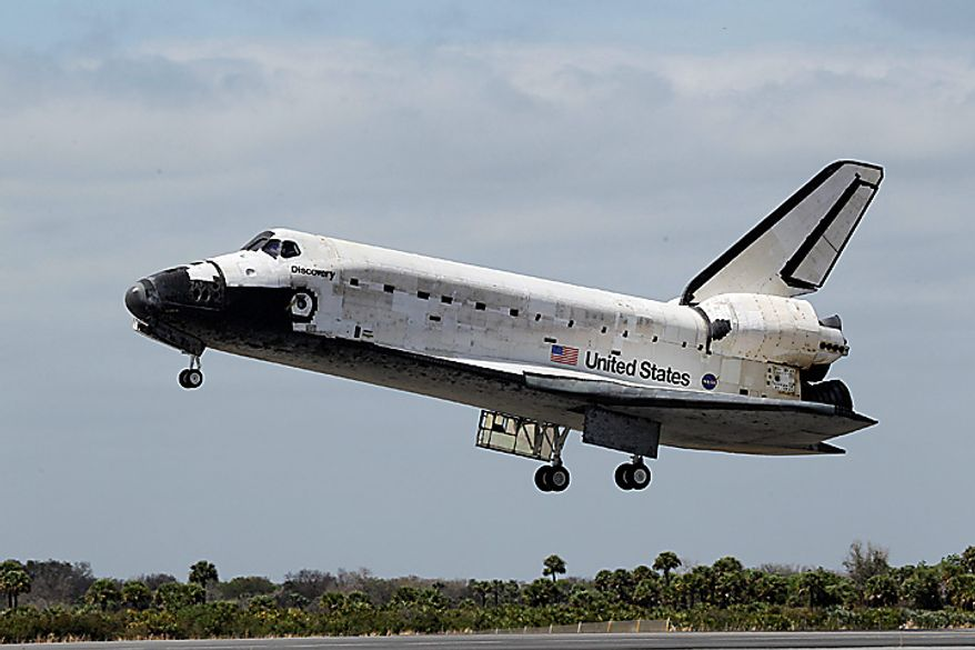 Space shuttle Discovery lands at the Kennedy Space Center at Cape Canaveral, Fla., on Wednesday, March 9, 2011. (AP Photo/John Raoux)