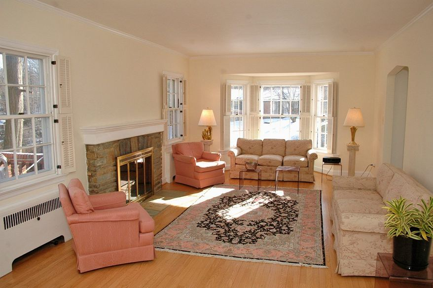 The living room has a bay window and a fireplace.