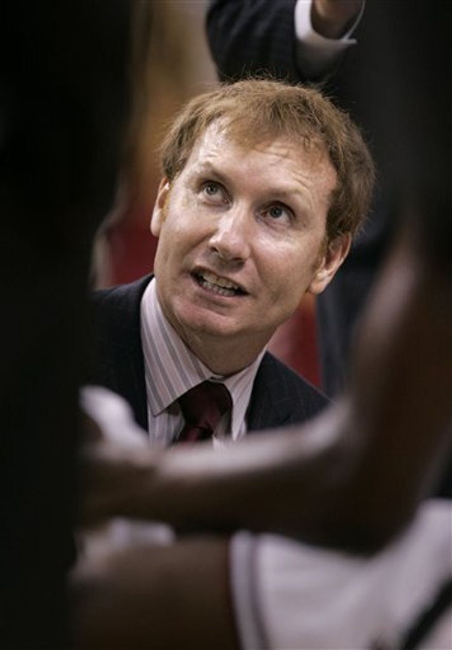 FILE - In this Dec. 30, 2009 file photo, Arkansas coach John Pelphrey talks to his team during a NCAA college basketball game in North Little Rock, Ark. Arkansas says it is reviewing a report suggesting coach Pelphrey had contact with a pair of 2012 recruits in violation of NCAA rules. (AP Photo/Danny Johnston, File)
