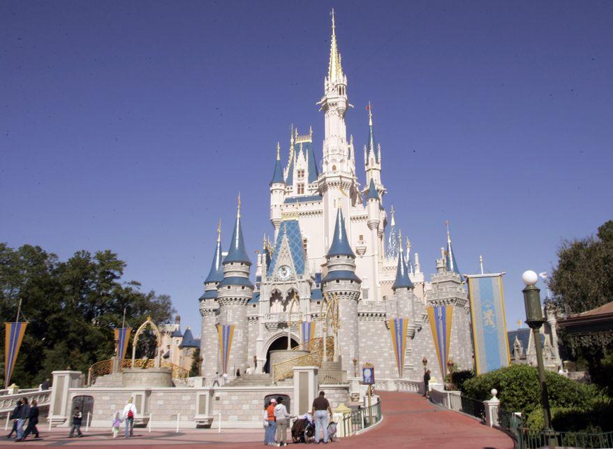 This Jan. 26, 2006, file photo shows Cinderella's Castle at Walt Disney World's Magic Kingdom in Lake Buena Vista, Fla. (AP Photo/Reinhold Matay, File)