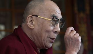 ** FILE ** The Dalai Lama, the Tibetan spiritual leader, speaks in Dharmsala, India, on Thursday, March 10, 2011, during the commemoration of the anniversary of the 1959 Tibetan uprising against Chinese rule. (AP Photo/Ashwini Bhatia)