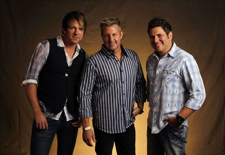 FILE - This Sept. 29, 2010 photo shows Joe Don Rooney, left, Gary Levox, and Jay DeMarcus, right, of Rascal Flatts in Nashville, Tenn.    (AP Photo/Mark Humphrey, file)