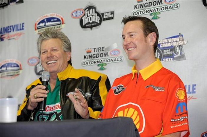 In this photo released by the NHRA, NHRA greats Don Garlits and John Force, center, and race car driver Kurt Busch, right, pose for a photo during a news conference Thursday, March 10, 2011 in Gainesville, Fla. Busch is making his NHRA Full Throttle Series debut in a Pro Stock car this weekend. (AP Photo/NHRA, Jerry Foss)