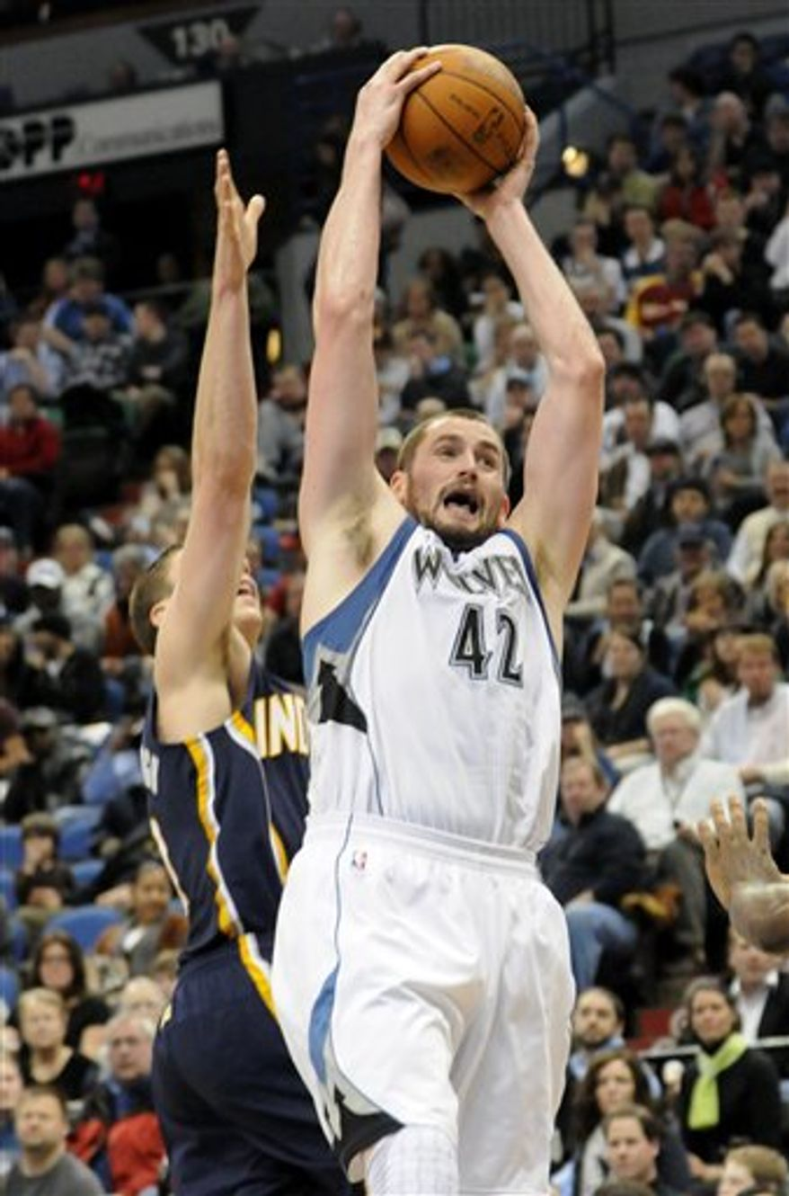 Minnesota Timberwolves' Kevin Love (42) beats Indiana Pacers' Tyler Hansbroughto the rebound in the second half of an NBA basketball game Wednesday, March 9, 2011 in Minneapolis. Love scored 16 points and had 21 rebounds as he set a record with his 52nd double-double in a row, passing Moses Malone in 1978-79 for the longest streak since the NBA-ABA merger in 1976.  The Timberwolves won 101-75. (AP Photo/Jim Mone)