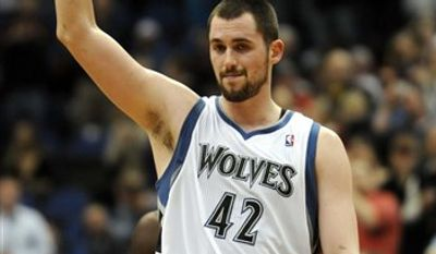 Minnesota Timberwolves' Kevin Love acknowledges the crowd's standing ovation after recorded his 52nd double-double in a row, surpassing Moses Malone for the longest streak since the ABA and NBA merged in 1976, in the first half of an NBA basketball game against the Indian Pacers in Minneapolis, Wednesday, March 9, 2011. (AP Photo/Pioneer Press, Scott Takushi)