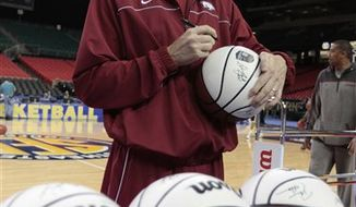 Arkansas coach John Pelphrey watches during an NCAA college basketball  practice Wednesday, March 9, 2011 in preparation for the Southeastern Conference tournament at the Georgia Dome in Atlanta Wednesday, March 9, 2011. (AP Photo/Dave Martin)