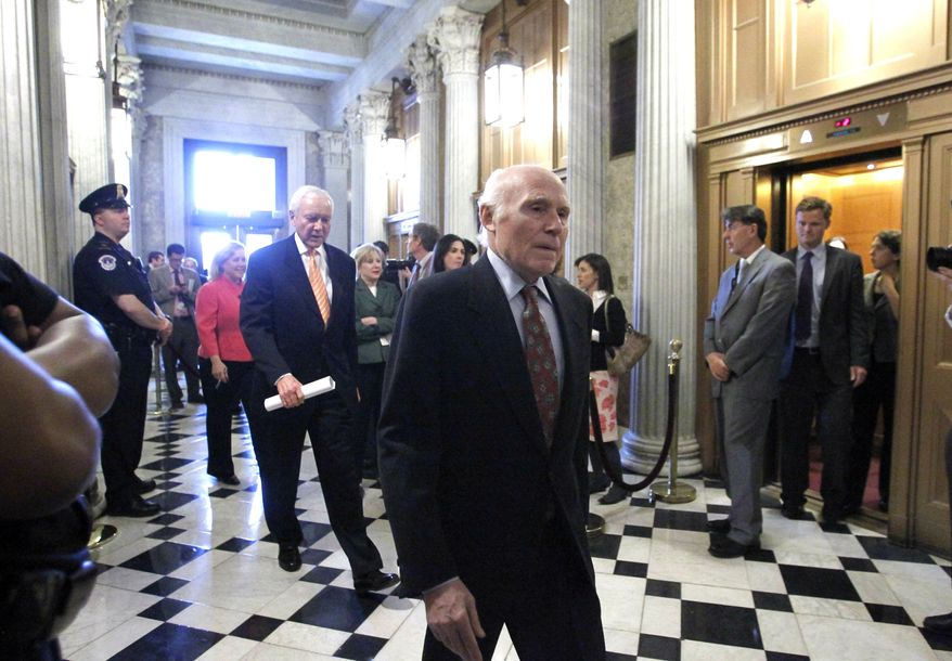 Sen. Herb Kohl, D-Wis., center, and Sen. Orrin Hatch, R-Utah, left, arrive to vote on the spending bill in the Senate, at the Capitol in Washington on Wednesday, March 9, 2011. The Senate rejected competing Republican and Democratic spending bills in a bit of Capitol theater designed to demonstrate that the combatants must meet somewhere in the middle. (AP Photo/J. Scott Applewhite)